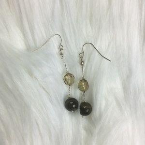 Dangling earrings, vermillion stones, silver tone.